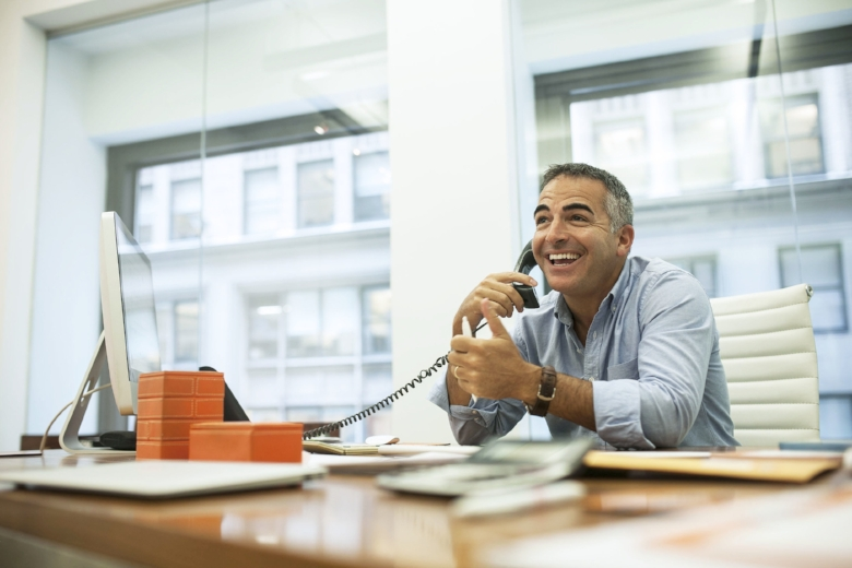 Happy business man on phone